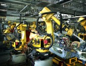 welding robots in a car manufactory